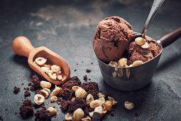 Vegan coconut chocolate ice cream with brownies and hazelnuts