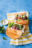 Falafel subs with pickled onions