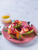 Avocado filled with vegetables and citrus fruit