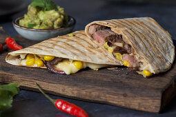 Quesadillas with steak, corn, cheese, coriander and guacamole