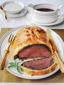 Bouef en Croute Fillet of Beef in pastry with rich gravy and horseradish sauce