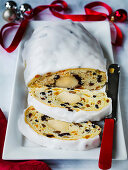 Iced German Stollen Christmas bread with nuts spices and dried fruit