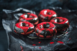 Beetroot donuts with two-tone chocolate icing for Halloween