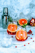 Cocktail with pomegranate seeds, grapefruit and ice