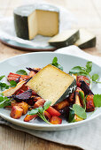 Warm cheese on roasted autumnal vegetables