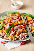 Quinoa with roasted vegetables and smoked ham