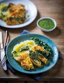 Polenta chicken with potato mash and salsa verde
