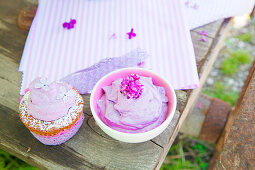 Muffin and lilac cream with lilac florets