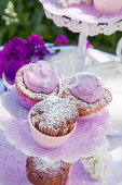 Muffins and lilac cream with lilac florets