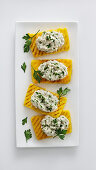 Grilled polenta slices with stockfish cream and parsley