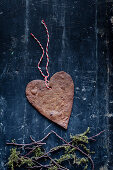 Heart shaped Christmas ginger biscuits with decorative string