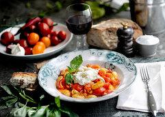 Gnocchi with tomatoes, buffalo mozzarella and basil