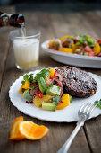 Vegetarian steaks with orange and avocado salsa