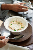 Cream of cauliflower soup with lemon confit and almonds