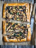 Walnut galette with mushroom cream, mushrooms and baby spinach