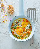 Fried eggs with colourful vegetables