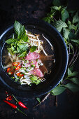 Pho Bo with beef fillets, sprouts, chillies and lime