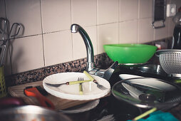 Faucet and dirty dishes