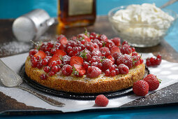 Juicy almond and amaretto cake with fresh berries