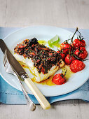 Roast Cod topped with olive and sun dried tomato tapenade and roast tomatos