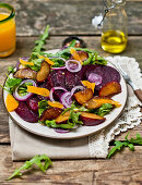 Autumn salad with beetroot and plums