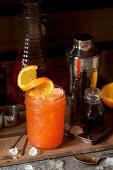 Aperol Cocktail with an Orange Garnish