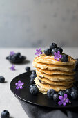 Stack of appetizing tasty crumpets with blueberries