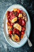 Pepper and aubergine medley with tomatoes on a serving platter