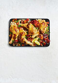 Feta-stuffed chicken tray bake with couscous