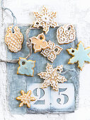 Ginger cookie Christmas tree decorations with white and blue icing