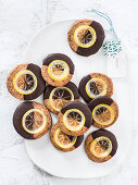 Cranberry cookies with chocolate icing and candied lemons