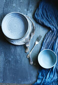 Ceramic bowls, plates and forks