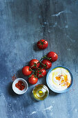 Cream, tomatoes, olive oil and paprika
