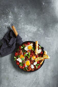 One-pan spicy meatballs with kale and eggs