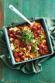 Zucchini noodle and sweet potato casserole with cherry tomatoes