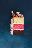 A piece of Neapolitan Kitkat layer cake