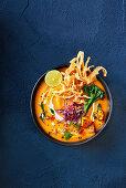 Thai slow-roasted pumpkin soup with crispy wonton noodles