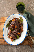 Braised beef cheek with carrots and bacon