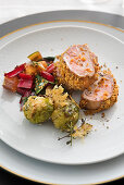 Pork fillet with a mustard gingerbread crust, brussels sprouts and chard