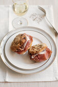 Apricot and rosemary rolls with prosciutto