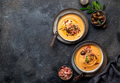 Salmorejo (Spanish tomato cold soup), served with ham serrano and olives