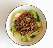 Spicy duck with sautéed bok choy