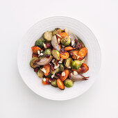 Oven-roasted Brussels and carrot medley with cranberries and pecan nuts