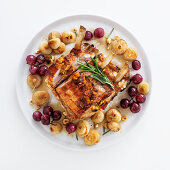 Roasted rack of veal with grapes, onions and hazelnuts