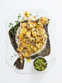 Plaice with a potato and artichoke crust and courgette pesto