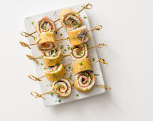 Pancake rolls with smoked salmon and goat's cheese cream