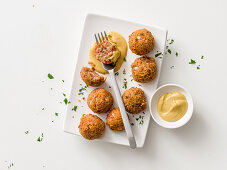 Lentil and sausage balls with honey mustard