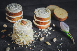 Layered cakes with marzipan cream and almonds