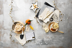 An astrology still life with star signs, star decorations, soft cheese and white chocolate