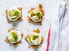 Cinnamon graham crackers toppped with yogurt and chopped green apples drizzled with honey